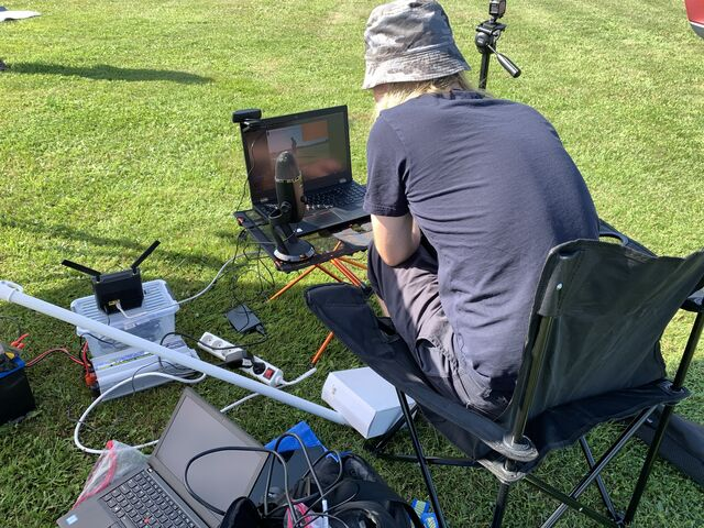 Mikael OH3BHX checking that the YouTube stream is running fine and that we're receiving the DVB-S1 video from the balloon payload. (photo by OH7Z)
