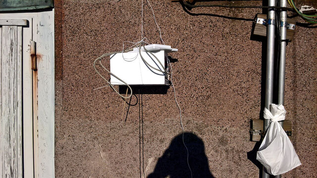 The balloon payload box hanging on the top of the observation tower. The antenna is sticking out of the bottom of the box.