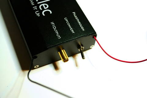 The wires can go through screw holes of the upconverter enclosure